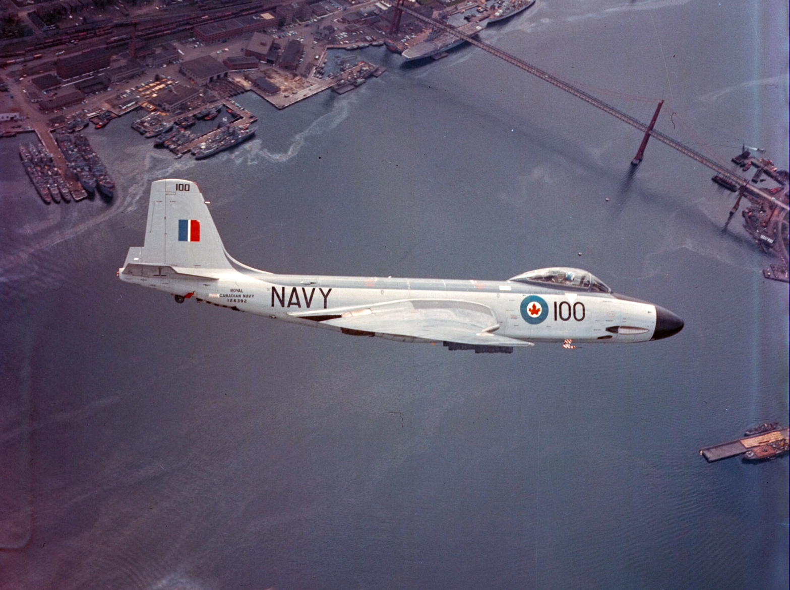 A Banshee flies over Halifax Harbour in Nova Scotia. Phtoto: DND Archives, RNC-131