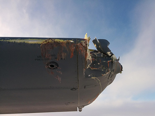 The assessment of the damage to the structure on the outer two feet of the left wing was classified as C category damage.