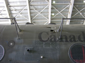 Damage to the fuselage left side and to the HF antennae