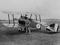 Major William G. Barker stands in front of a Sopwith Camel, circa 1918.