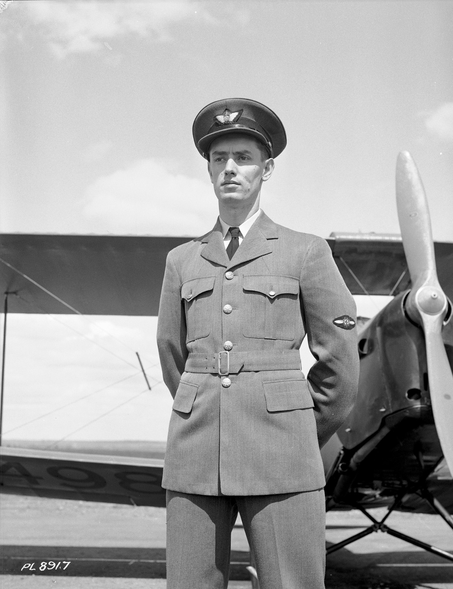 A civilian instructor wears his standard grey British Commonwealth Air Training Plan uniform. PHOTO: DND