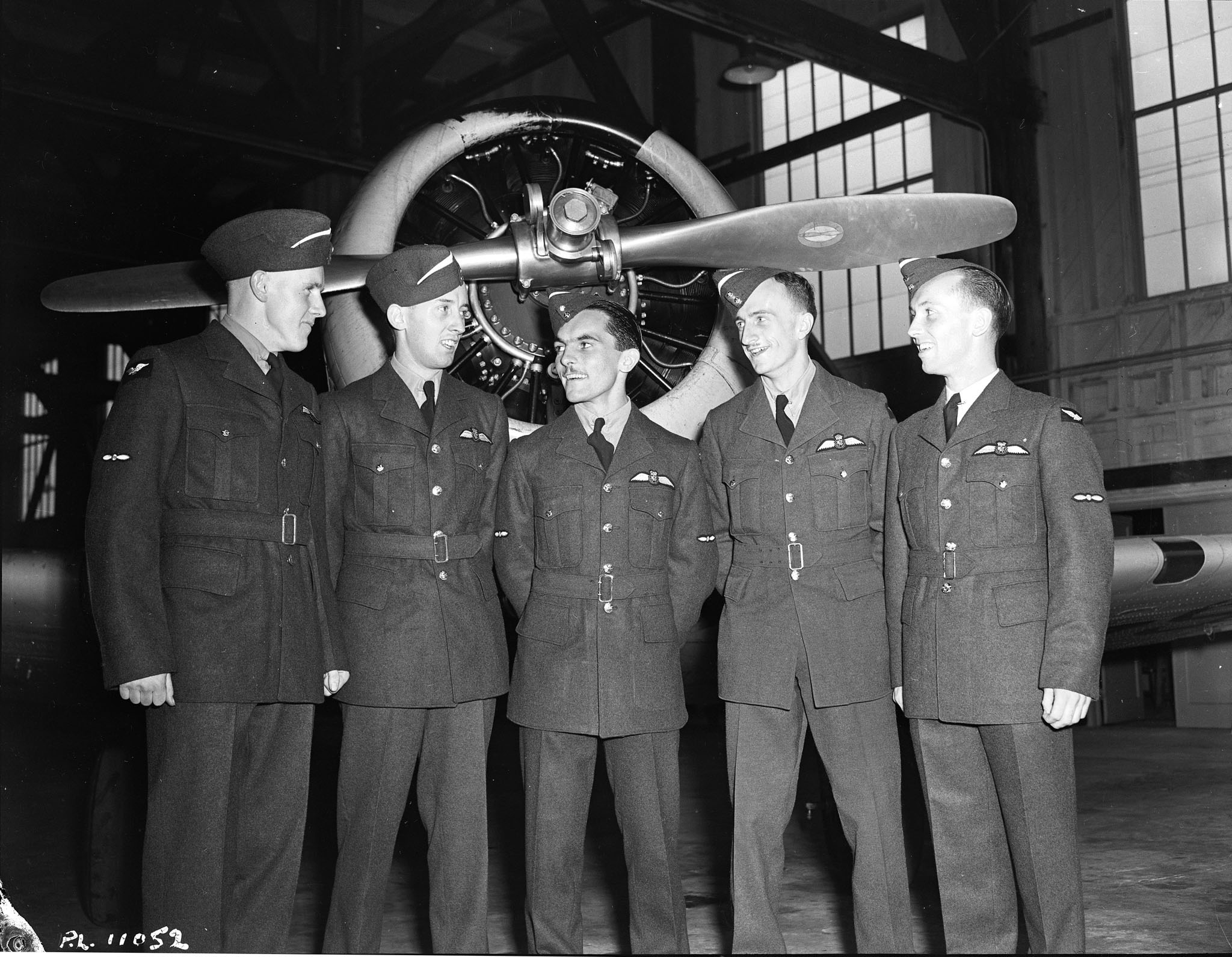 Toronto, Ontario, pilots Morrison (left), Nixon, Regan, Richards and Riddell stand for a photograph to commemorate their graduation from RCAF No. 2 Service Flying Training School at Uplands, Ontario, on August 28, 1942. PHOTO: DND Archives