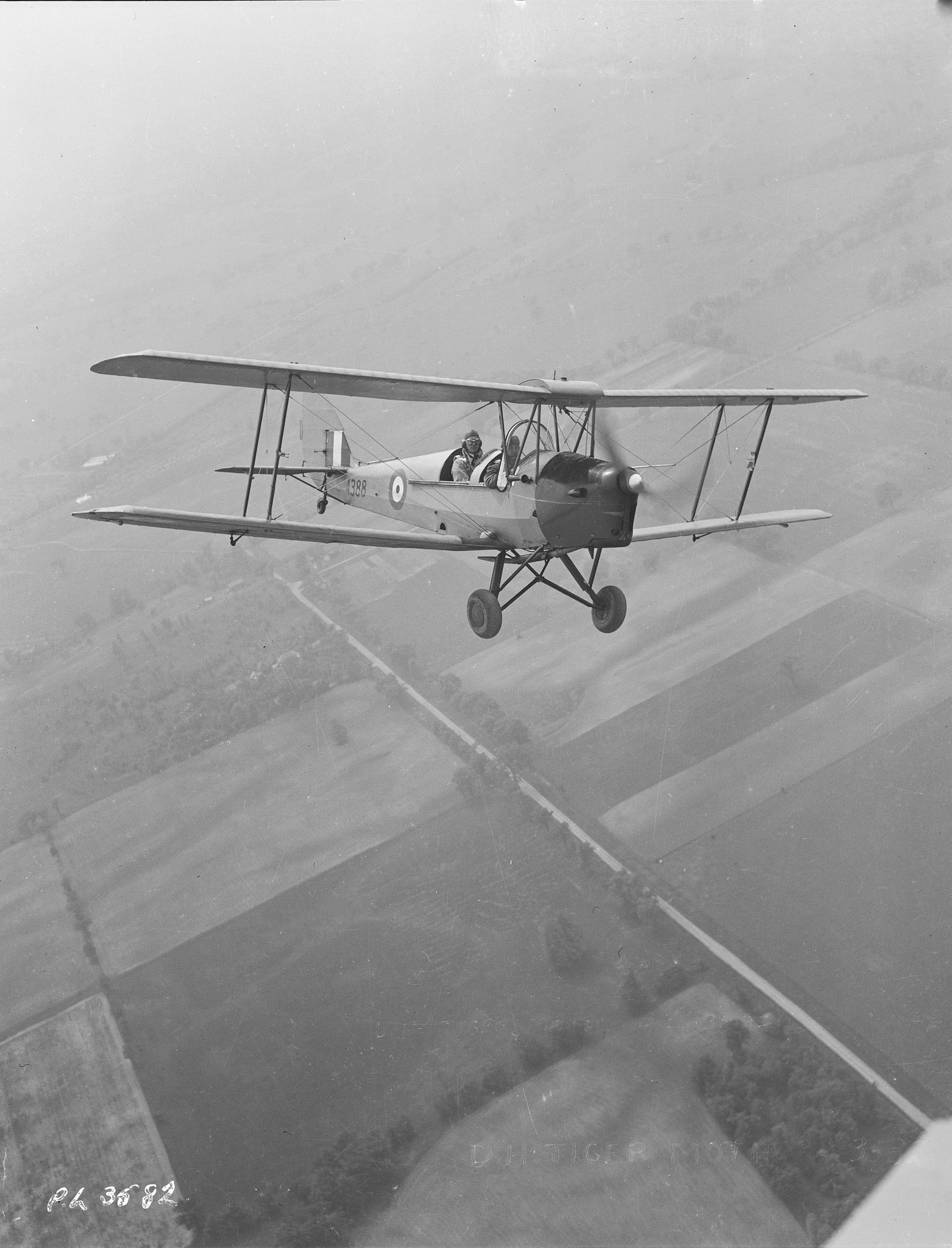 A Tiger Moth flies out of No. 1 Elementary Flight Training School at RCAF Malton, Ontario. Almost all of the pilots under the British Commonwealth Air Training Plan in Canada began their flight training on Tiger Moths. PHOTO: DND Archives, PL-3582