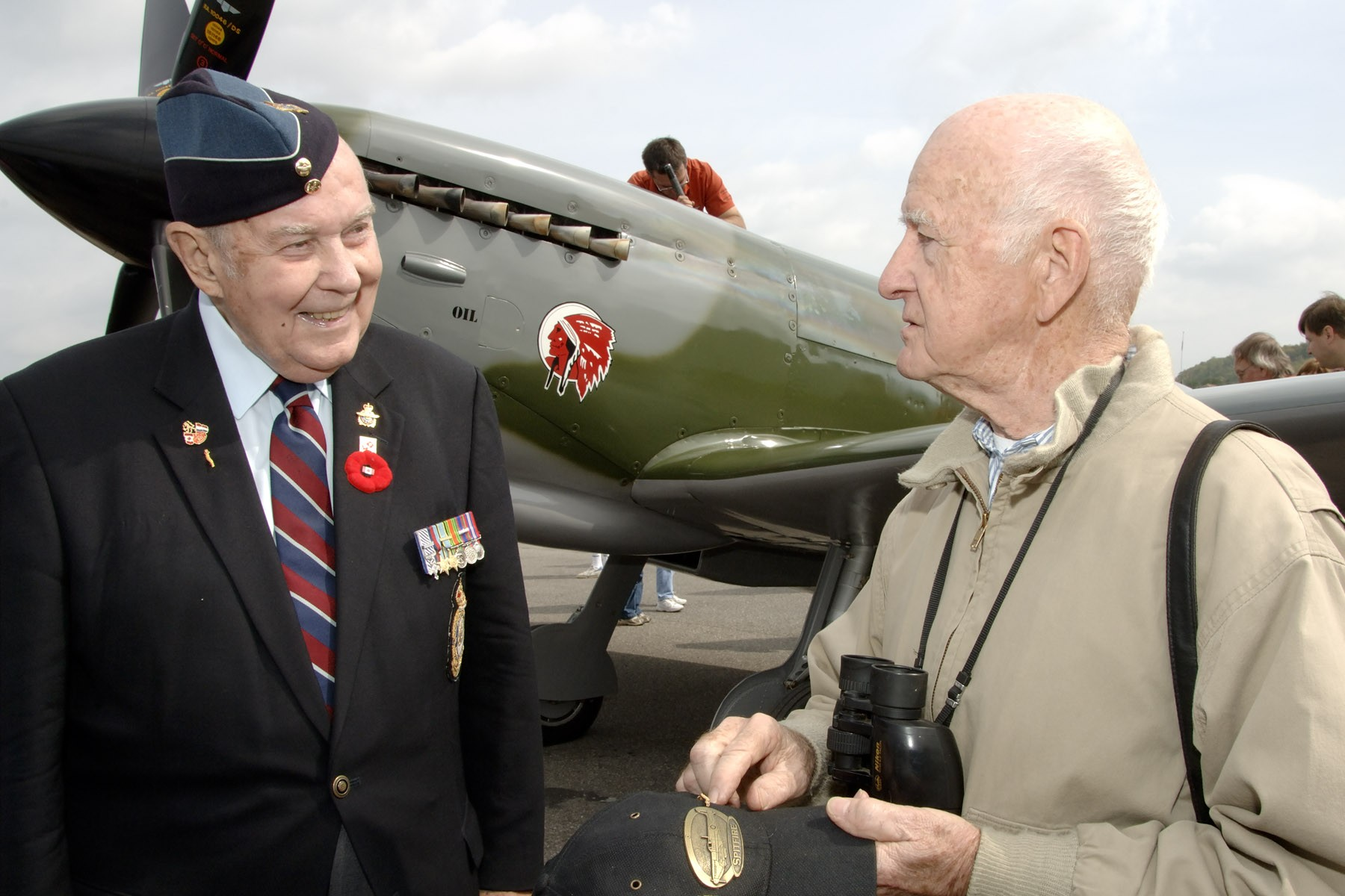Flight Lieutenant (retired) Charley Fox (left), who was the honorary colonel of 412 Transport Squadron, and Vernon Mullen stand in front of a Spitfire, similar to the ones they flew in during the Second World War, following the 2006 national Battle of Britain ceremony in Ottawa. Honorary Colonel Fox died in October 2008. PHOTO: Warrant Officer Serge Peters