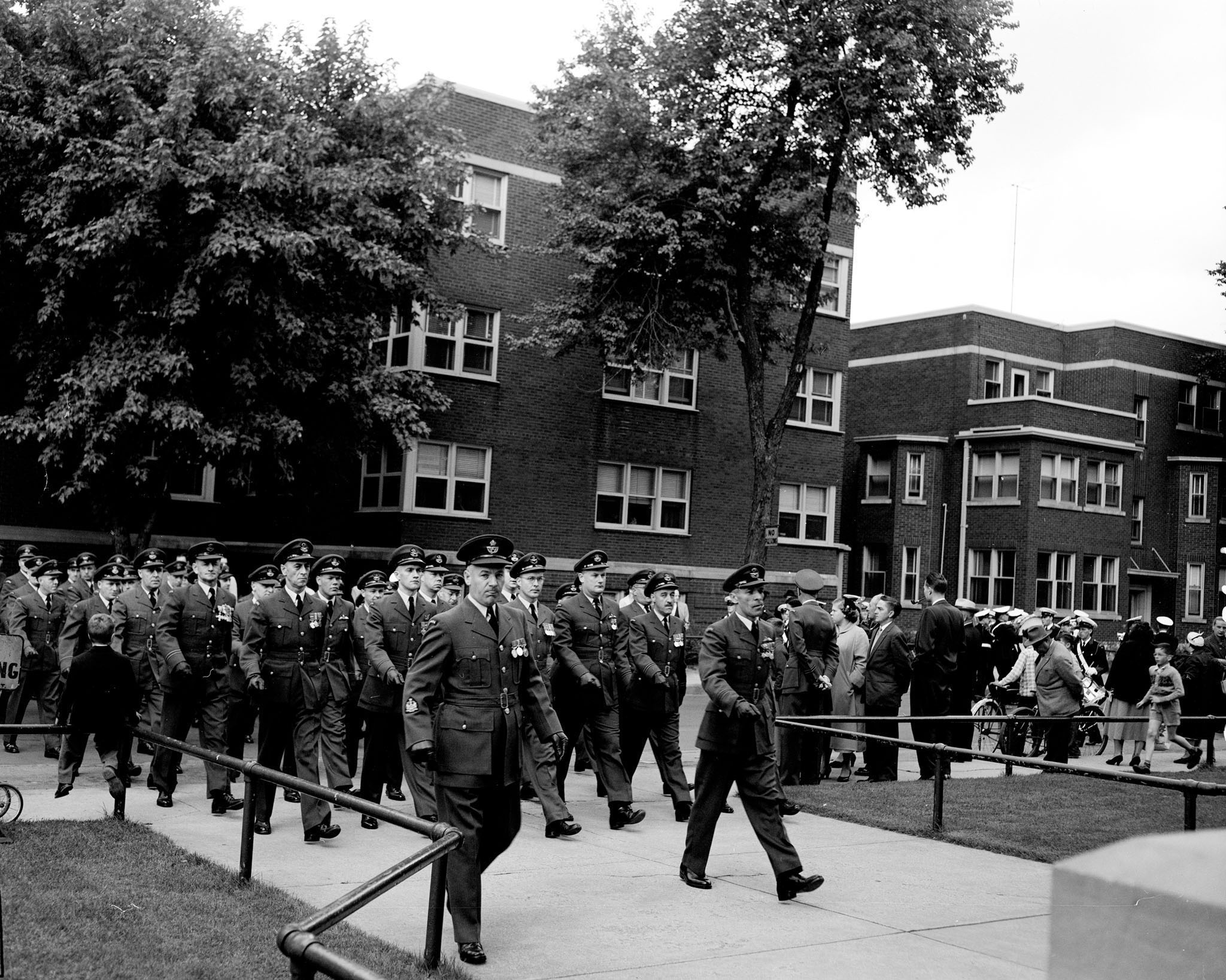 During the Battle of Britain parade held in Ottawa on September 16, 1956, the Roman Catholic section of the parade marches into their church. Church services continue to be part of Battle of Britain ceremonies in many locations. PHOTO: PL-105194, DND Archives