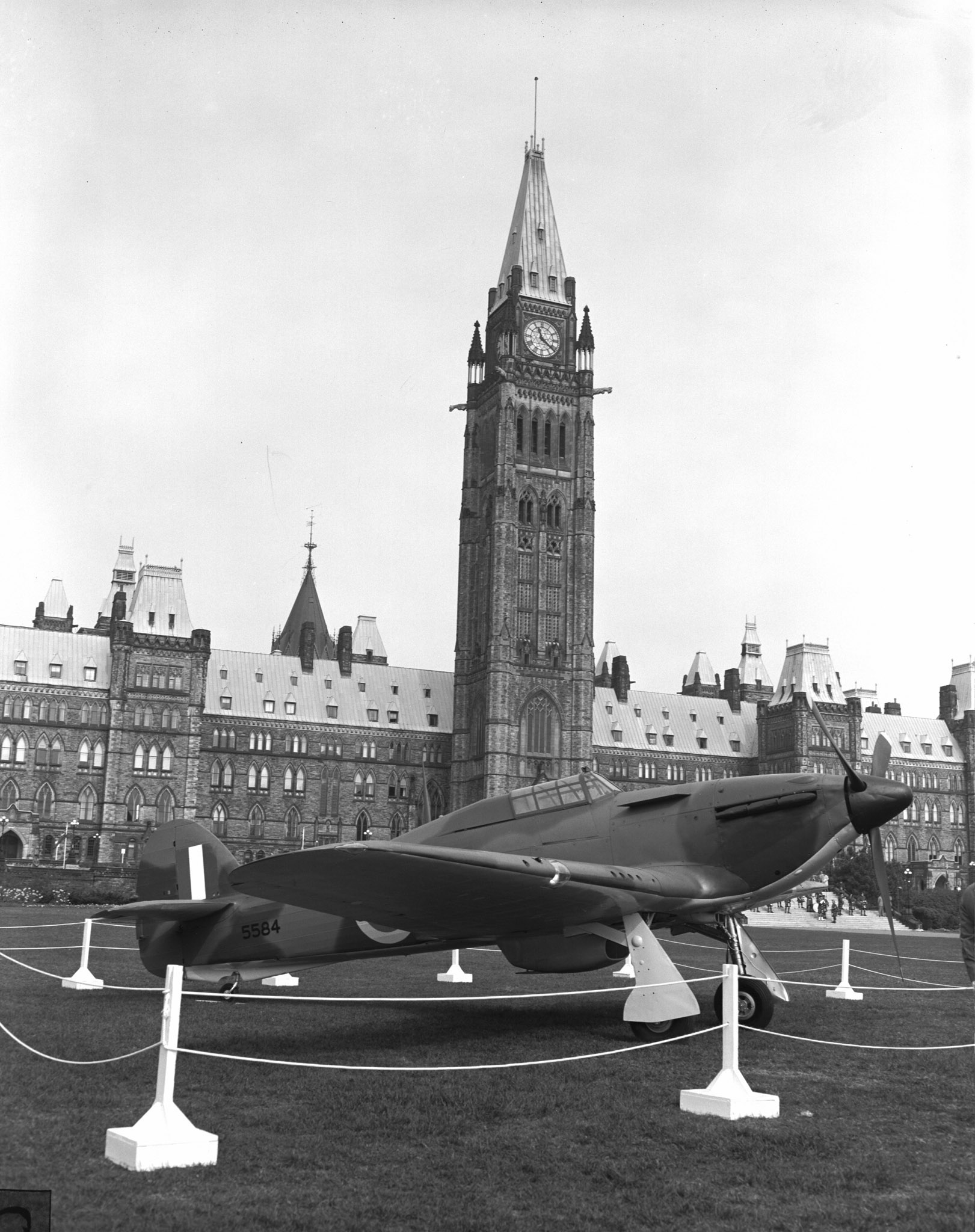 A Hawker Hurricane is displayed on the lawn of Parliament Hill during the Battle of Britain commemoration ceremony in 1960. PHOTO: PL-129420, DND Archives