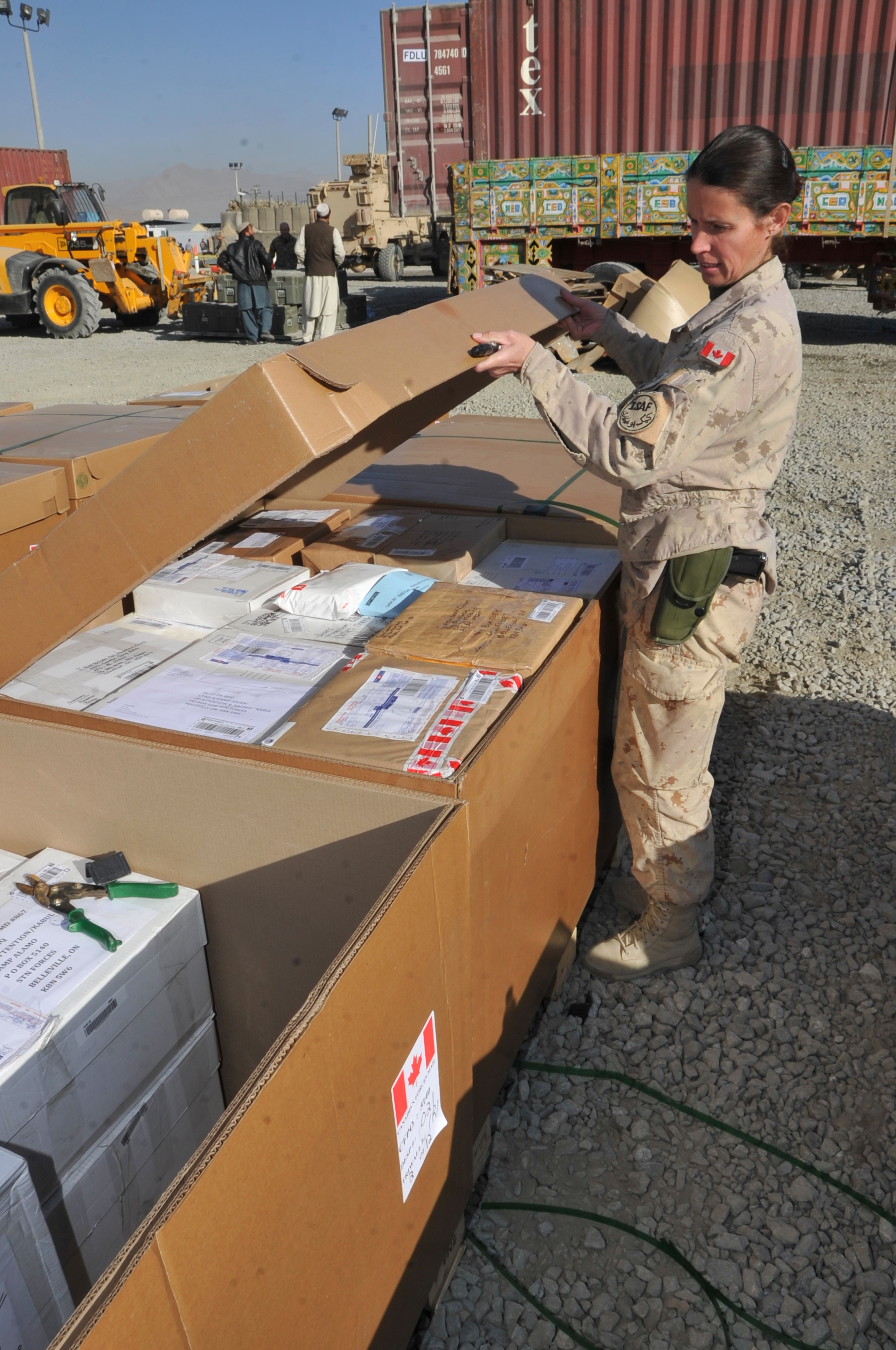 One thing that makes Christmas special for Canadians serving overseas is the deluge of letters and parcels received from friends, family and even strangers back home. Here, Master Corporal Jennifer Jodrey, assistant postmaster for Canadian Armed Forces members based in Afghanistan in 2011, opens a container of parcels at Camp Phoenix in Kabul. The mail was collected at 8 Wing Trenton, Ontario and flown to Kabul. PHOTO: Major Glen Parent