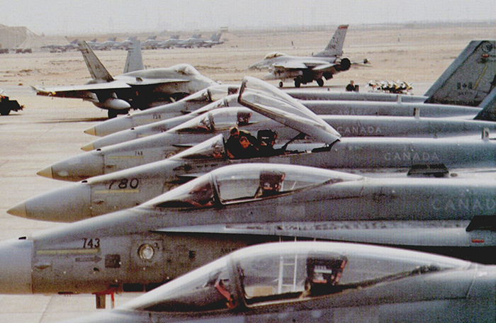 slide - A group of CF-188 Hornets line up on the flight line in Qatar.