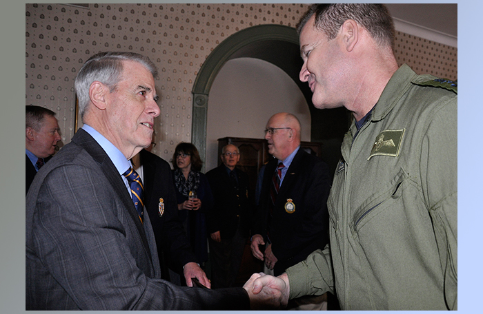 slide - Lieutenant-General Michael Hood, Commander Royal Canadian Air Force, exchanges greetings with Brigadier-General (ret'd) Jim Grant, Lieutenant Governor of Nova Scotia, during the commander's January 13, 2016, stop at Royal Artillery Park in Halifax, Nova Scotia.