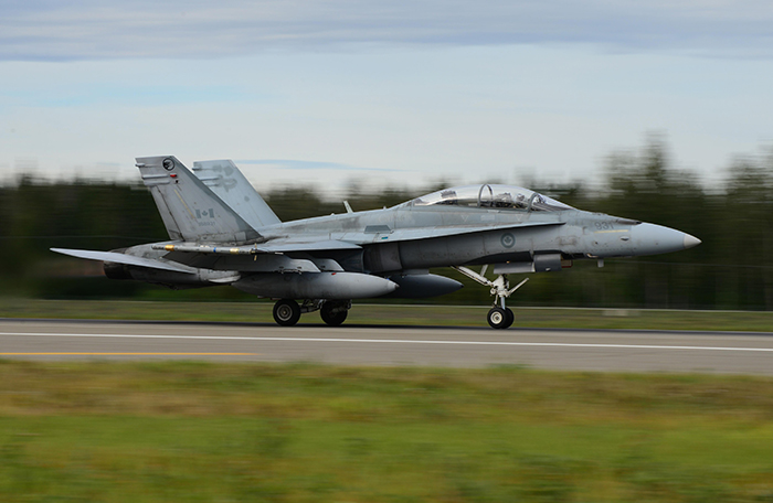 slide - A CF-188 Hornet takes off.