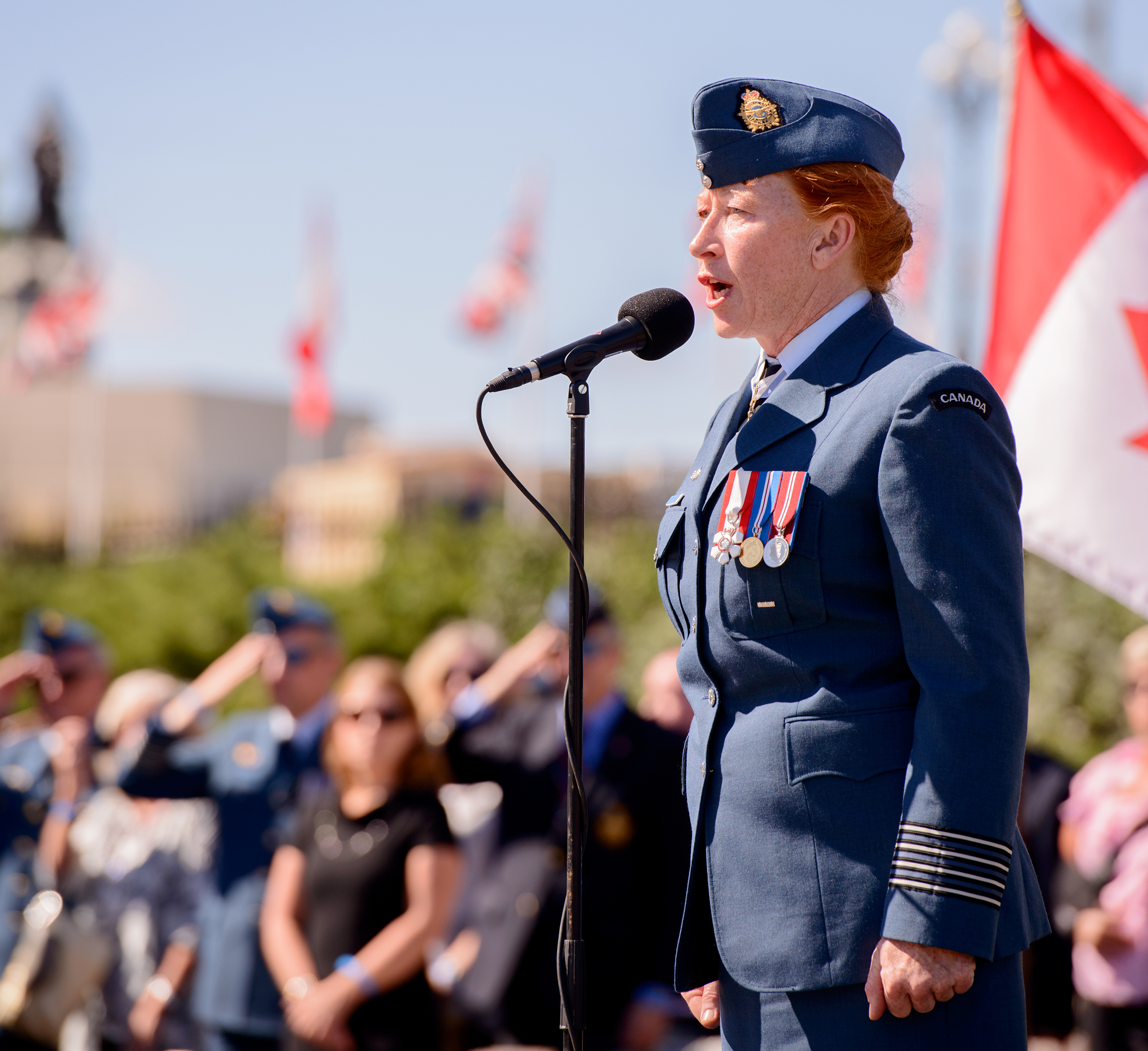 "Honorary Colonel Loreena McKennitt, renowned Canadian singer-songwriter and honorary colonel of the Royal Canadian Air Force, sings ""O Canada"" during the national ceremony marking the 75th anniversary of the Battle of Britain, held on Parliament Hill on September 20, 2015. PHOTO: Master Corporal Daniel Merrell, SU03-2015-0736-078"