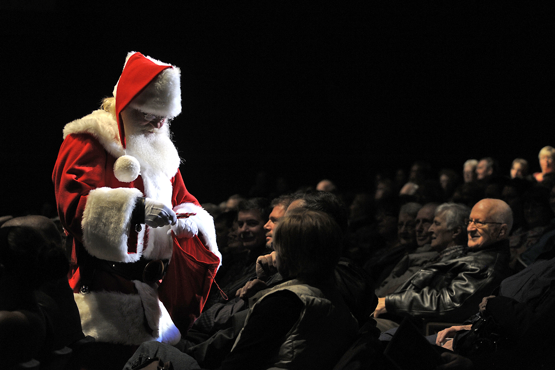 "Santa Claus, who keeps track of everyone – military and civilian – on his naughty and nice list, visits during a ""Coach 4 Food"" event in North Bay, Ontario. The annual initiative supports the North Bay Food Bank. PHOTO: Corporal Rob Ouellette, NB2013-0230-03"