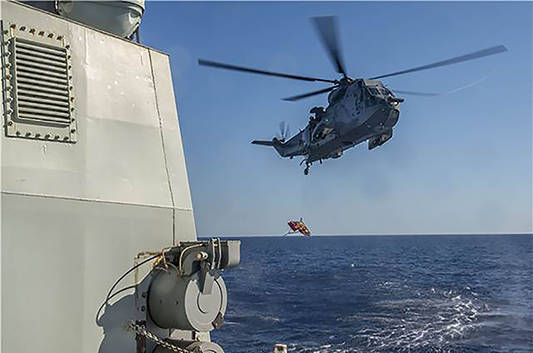 On July 17, 2016, during Operation Reassurance, the RCAF CH-124 Sea King helicopter and aircrew embarked in Her Majesty's Canadian Ship Charlottetown conduct casualty hoisting exercises from the flight deck of the ship in the Mediterranean Sea. PHOTO: Corporal Blaine Sewell