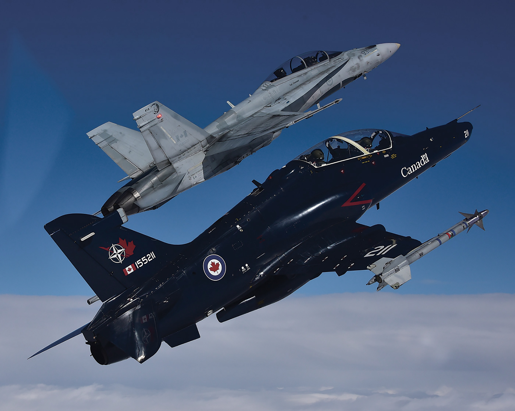 Eye on the prize: From the CT-155 Hawk trainer (foreground), the next step is the CF-188 Hornet, Canada's front-line fighter. PHOTO: Mike Reyno, Skies magazine