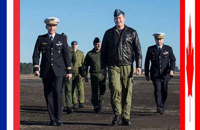 slide - Lieutenant-General Mike Hood (right foreground), commander of the Royal Canadian Air Force, walks with General André Lanata, chief of staff of the French Air Force in France.
