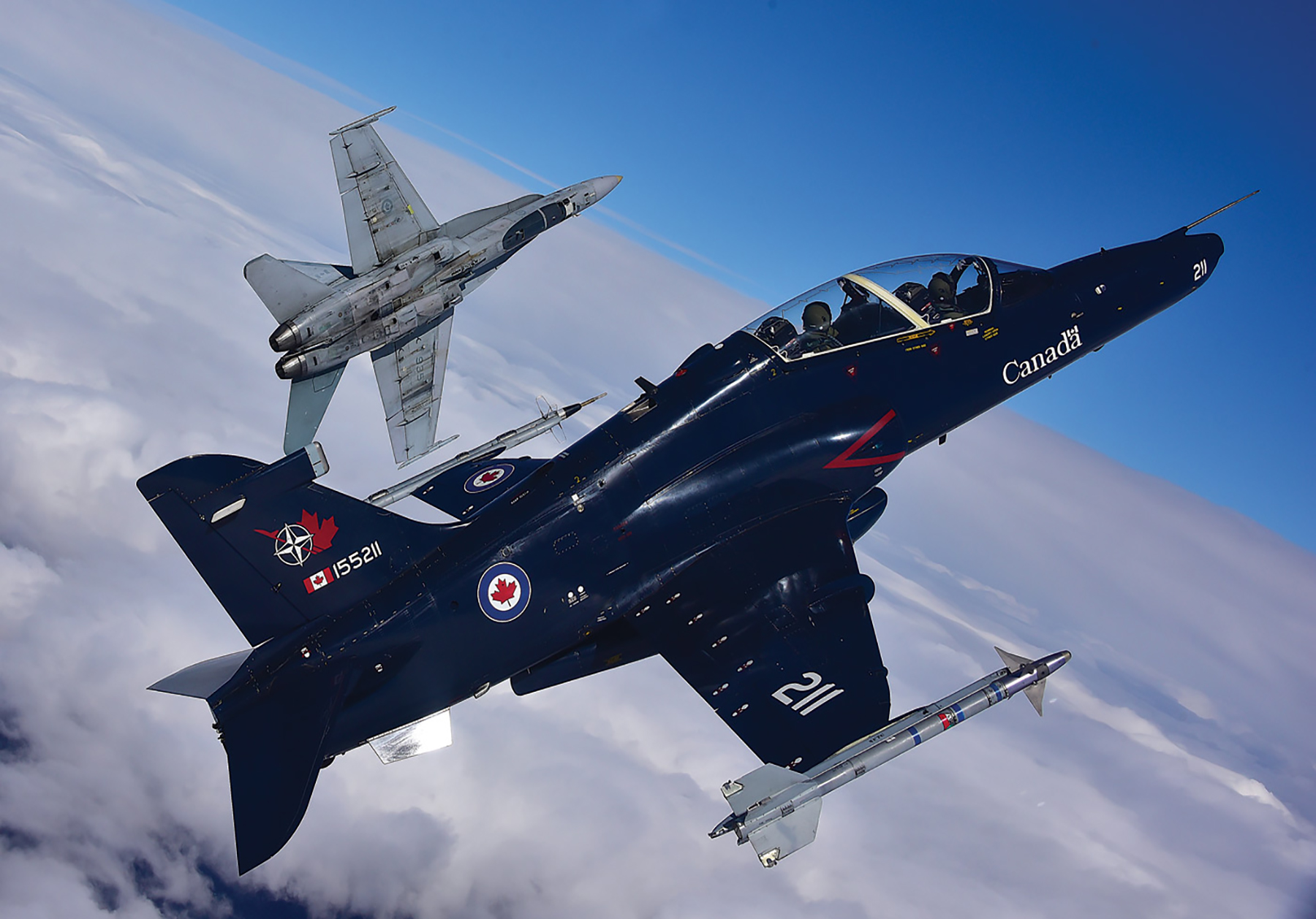 Stepping stone: The CT-155 Hawk provides students a solid base from which to transition to 410 Tactical Fighter (Operational Training) Squadron, where they will learn to fly the CF-188 Hornet (top). PHOTO: Mike Reyno, Skies magazine