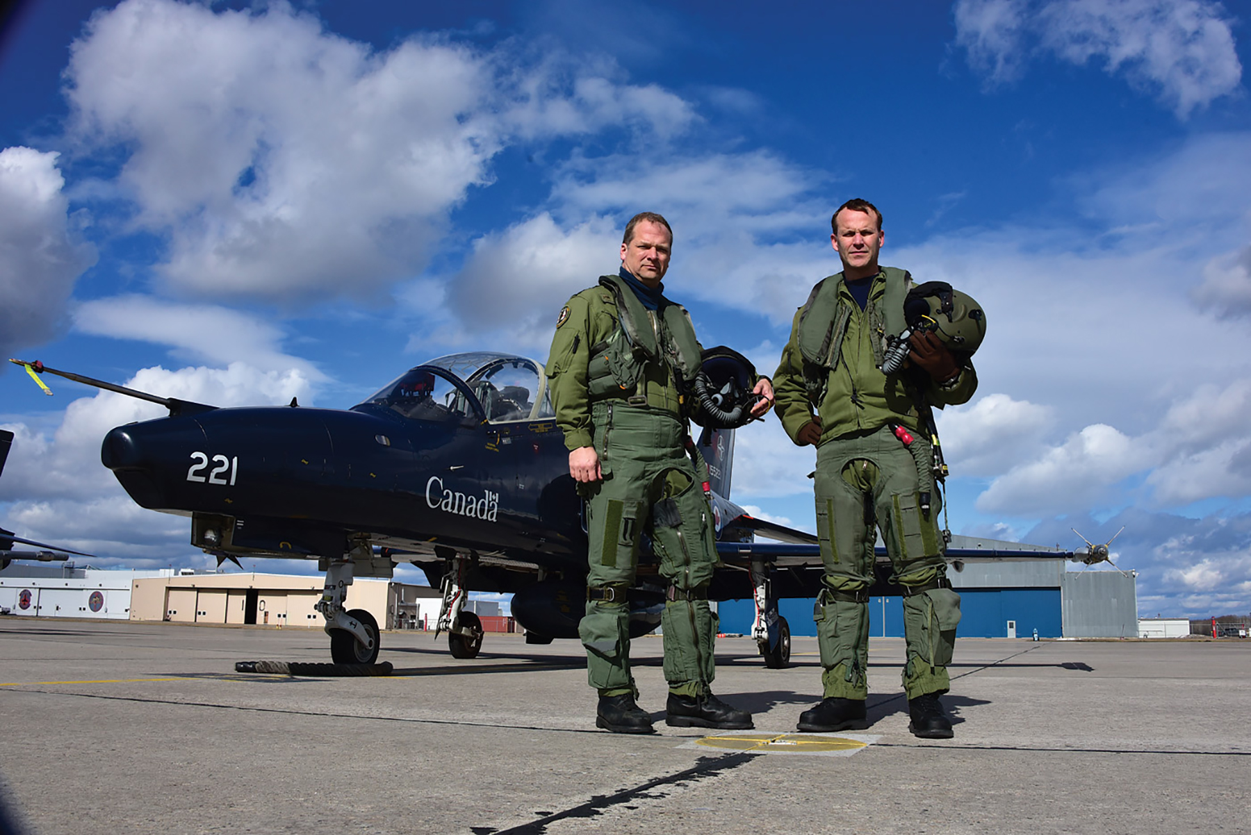 "419 Squadron's commanding officer Lieutenant-Colonel Mike ""Moose"" Grover (right) stands with his deputy commanding officer Major Carl ""Sleepy"" Cottrell. PHOTO: Mike Reyno, Skies magazine"