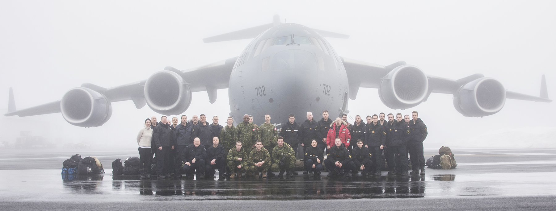 Canadian Armed Forces and Royal Canadian Mounted Police personnel gather for a photograph before boarding a CC-177 Globemaster aircraft, in Halifax, Nova Scotia, for the flight to Resolute Bay, Nunavut, on February 25, 2017, for Operation Nunalivut. PHOTO: Corporal Gabrielle DesRochers, is09-2017-0002-004