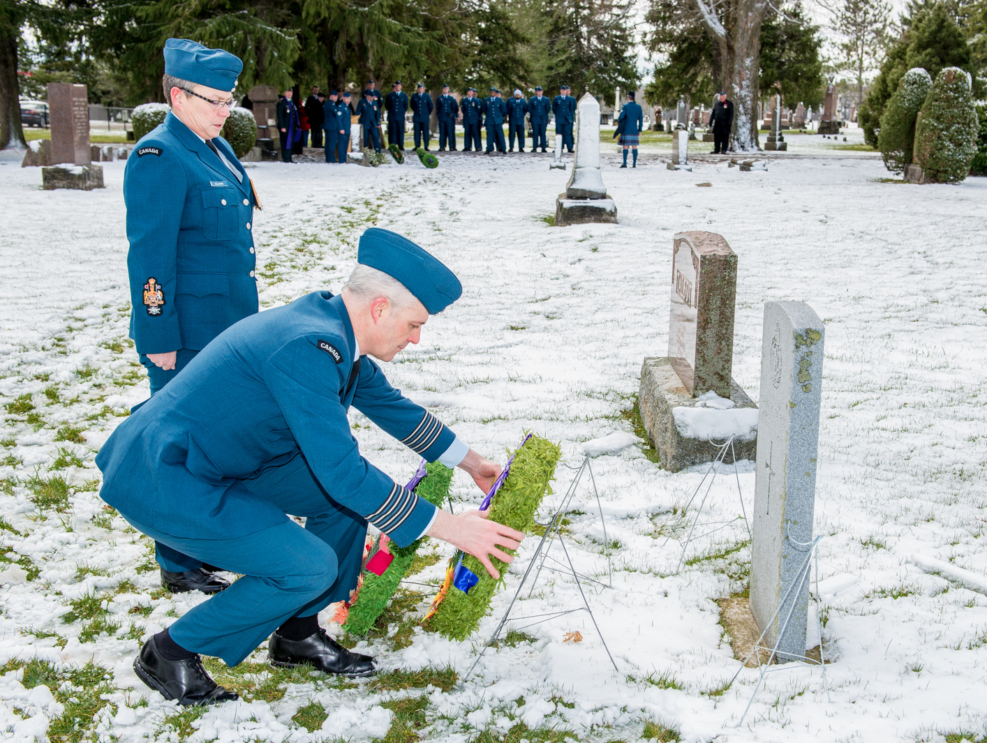 Accompanied by Chief Warrant Officer Necole Belanger, Colonel Andrew Fleming places a wreath at the grave of Cadet James Talbot on April 7, 2017. PHOTO: Corporal Aydyn Neifer, BM03-2017-0107-13