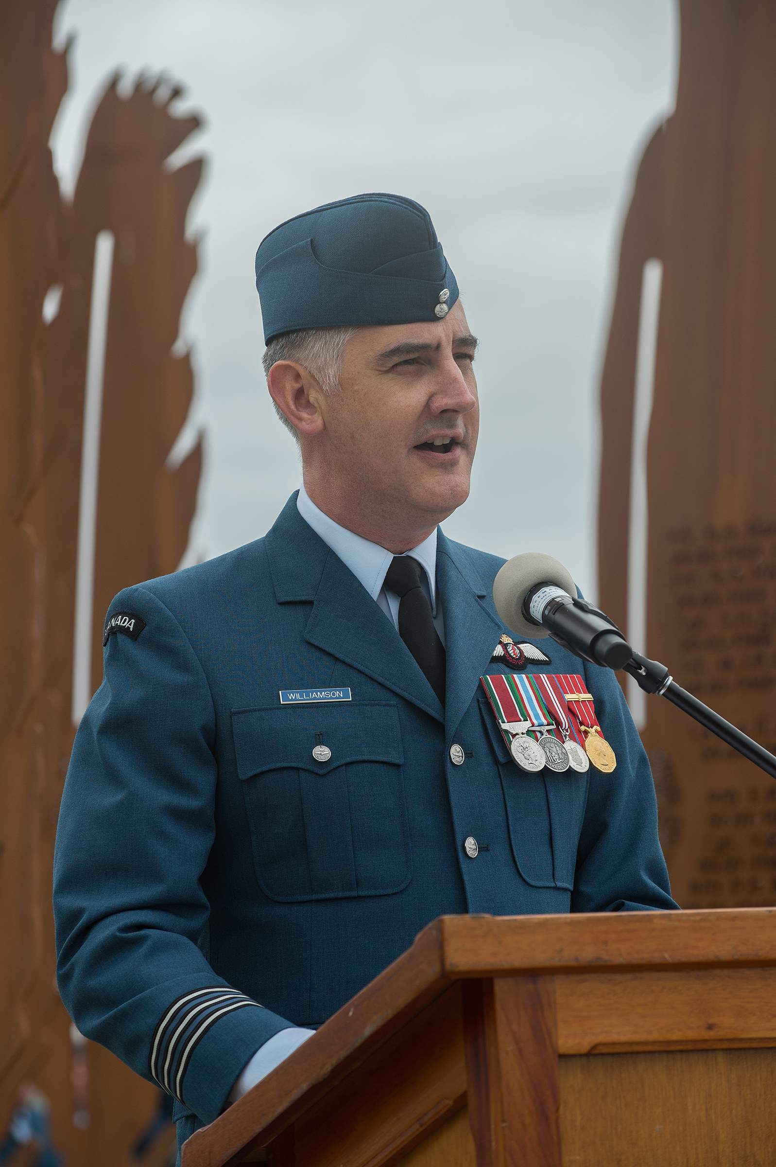 "Lieutenant Colonel Shown Williamson, commanding officer of 443 Squadron, speaks during the dedication of the ""Lost Airmen of the Empire"" memorial at Victoria international Airport on June 1, 2017. PHOTO: Master Corporal Chris Ward, ET2017-0159-13"
