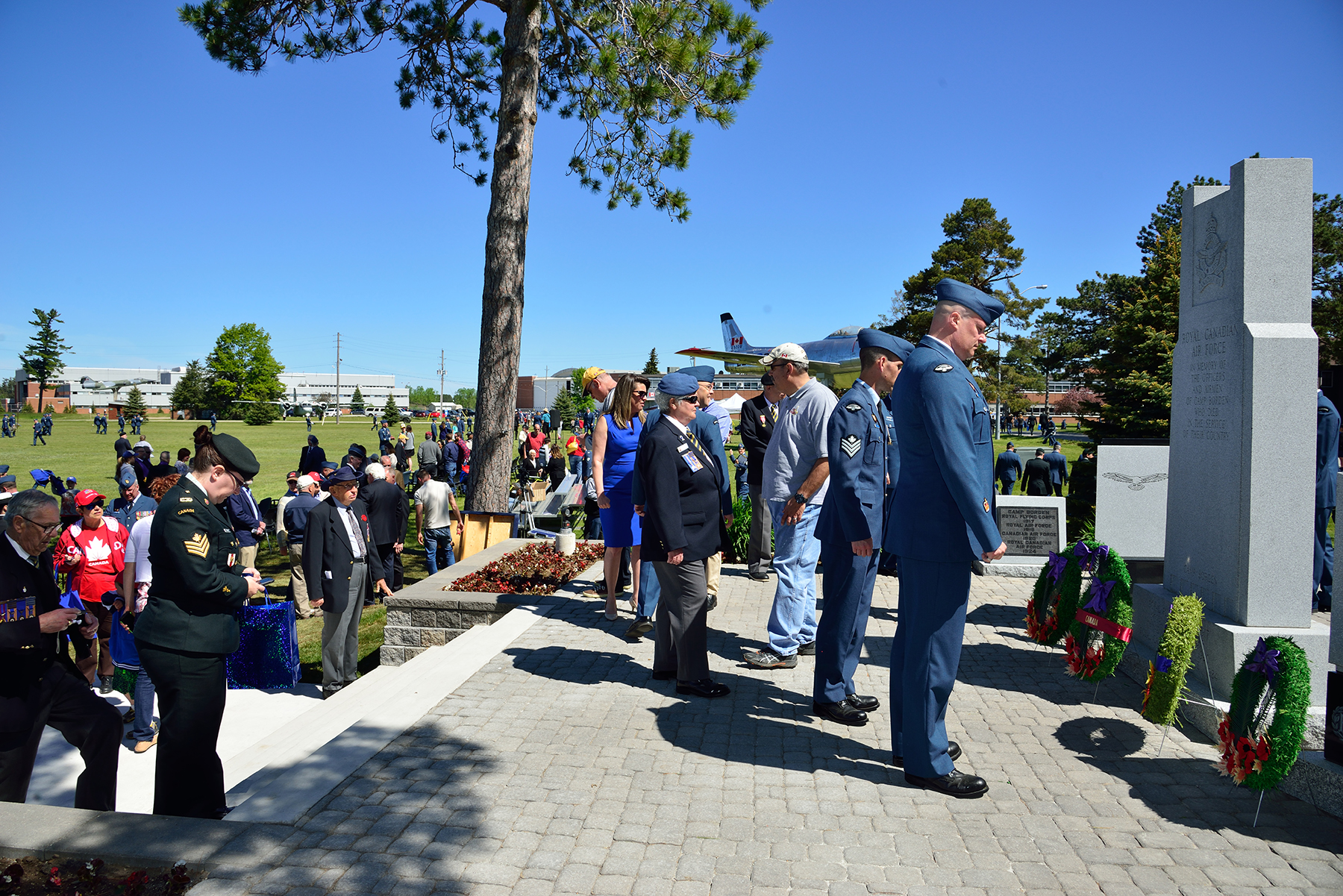 Military personnel, family members, and guests gather to get a closer view of the newly rebuilt Royal Canadian Air Force Memorial after the unveiling parade on June 3, 2017, at 16 Wing/Canadian Forces Base Borden, Ontario. PHOTO: Sergeant Christopher Bentley, BM01-2017-0174-171