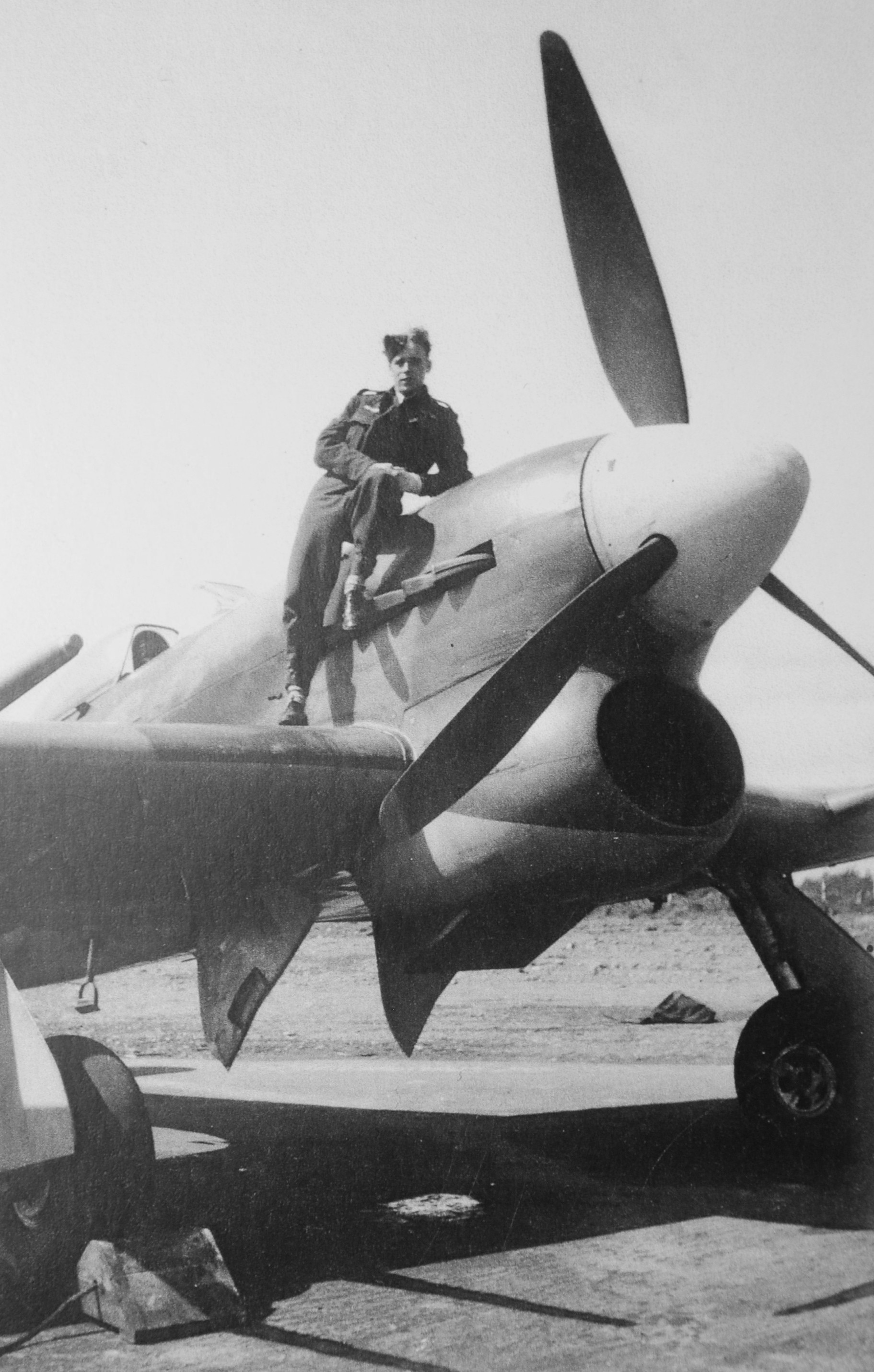 Flight Lieutenant John Colton perches on his Hawker Typhoon in Manston, England, in July 1944. PHOTO: Courtesy Flight Lieutenant (retired) John Colton