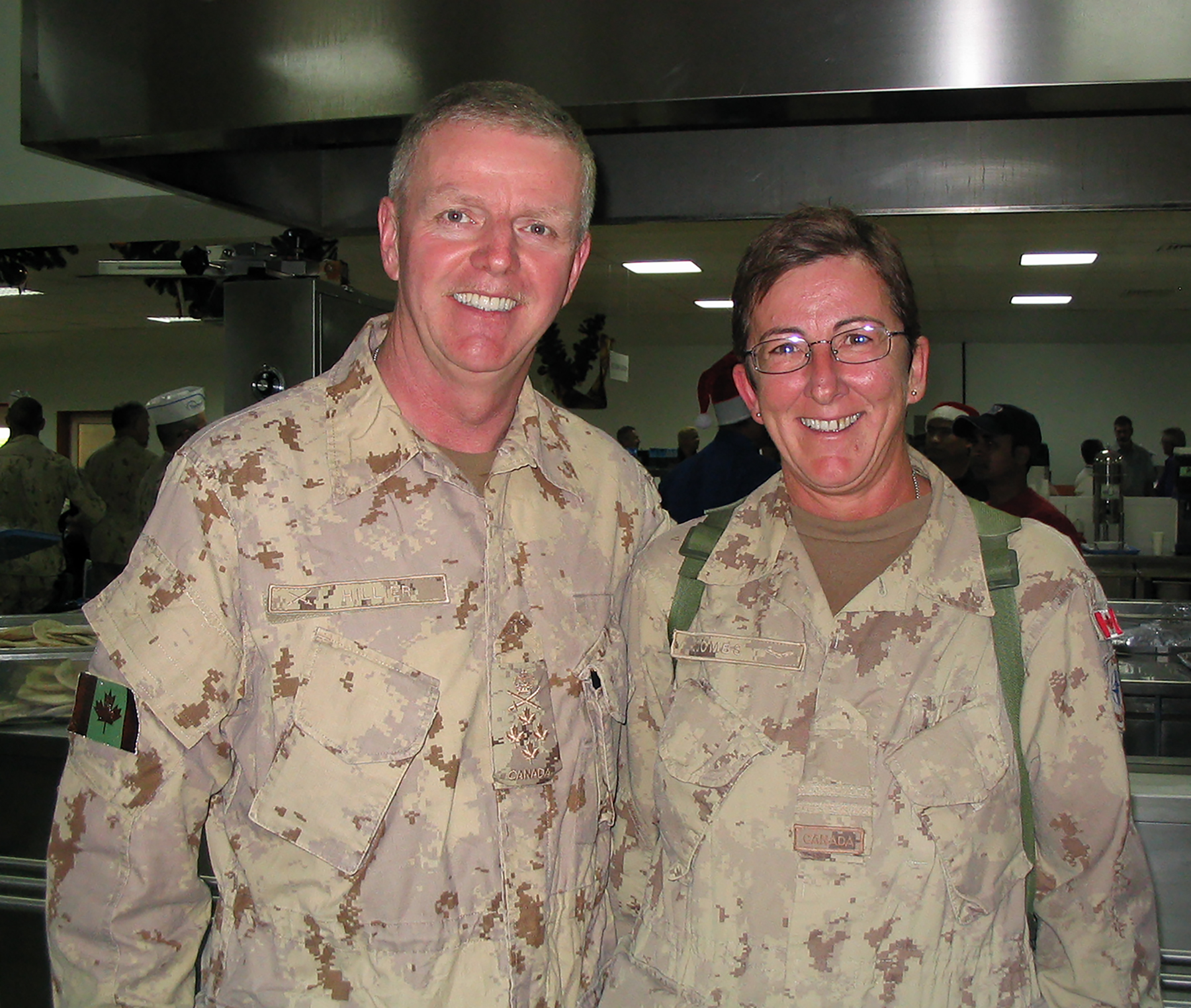 Then-Chief of the Defence Staff General Rick Hillier and Captain Cathy Coombs attend the 2007 Christmas Dinner in Afghanistan. PHOTO: Submitted