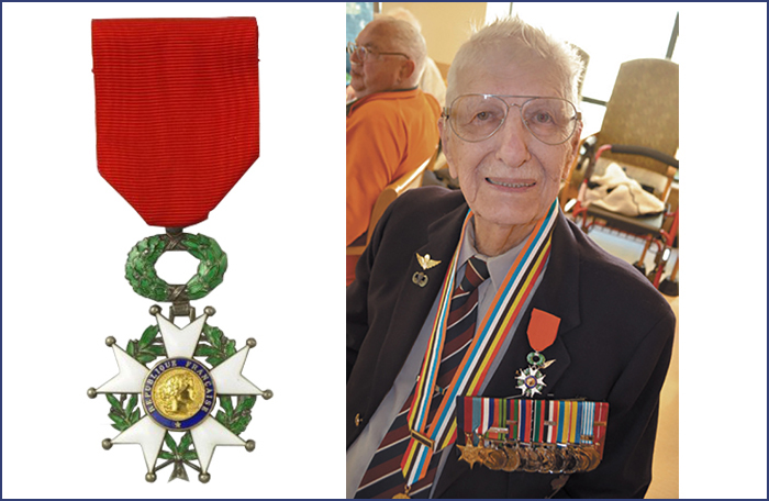 slide - An elderly man sits, wearing a blazer bearing many medals on ribbons.
