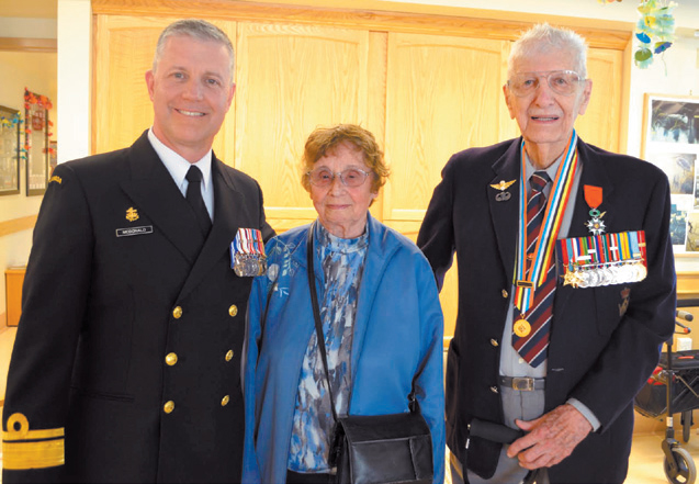 Rear-Admiral Art McDonald (left) presented the Légion d'honneur to Canadian veteran Frank Poole, with Mr. Poole's wife, Melodie, by his side. PHOTO: Lookout newspaper