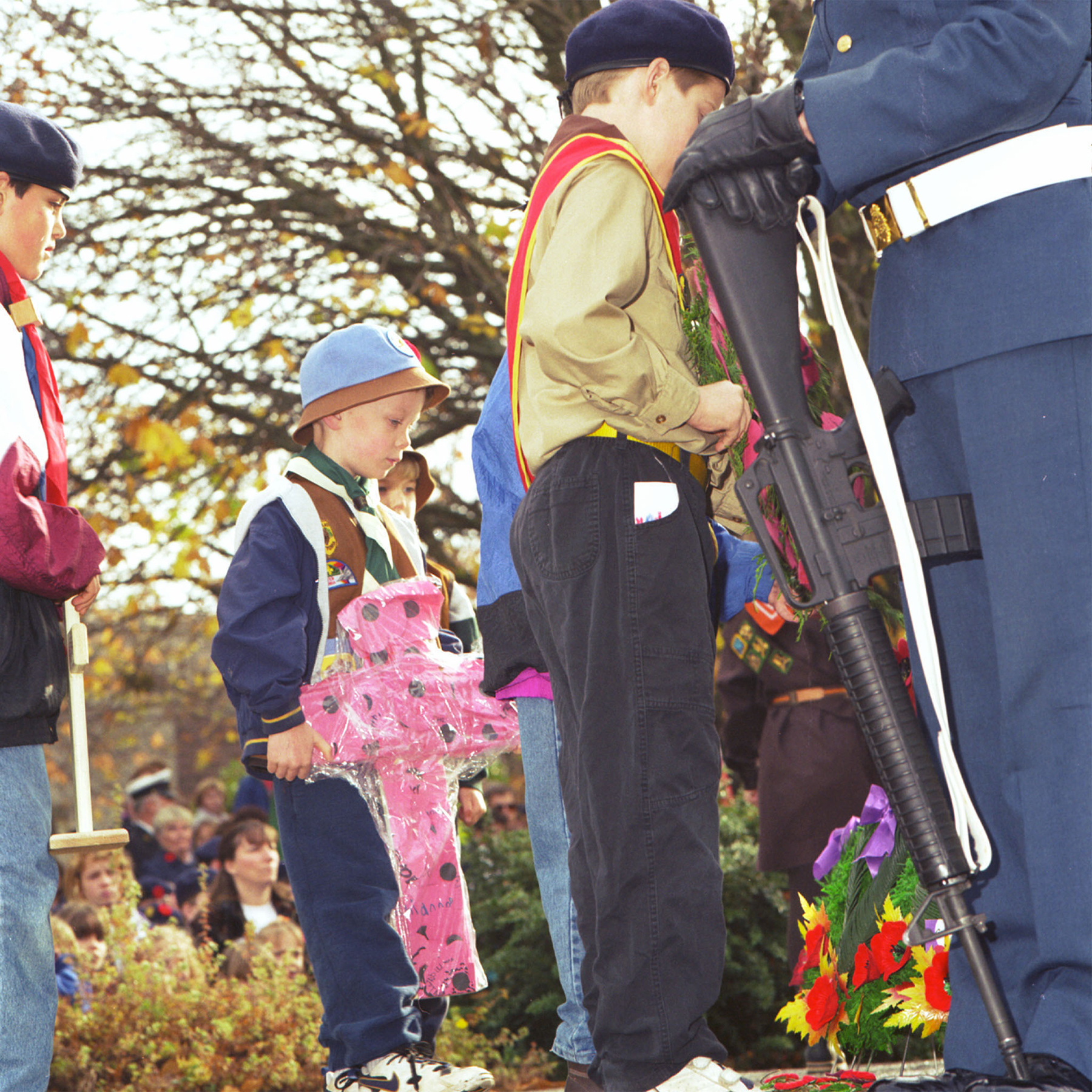 Members of a Beavers Cub Scout group lay a wreath at the cenotaph in Esquimalt, British Columbia, on Remembrance Day, November 11, 1996. PHOTO: ETC96-1411-