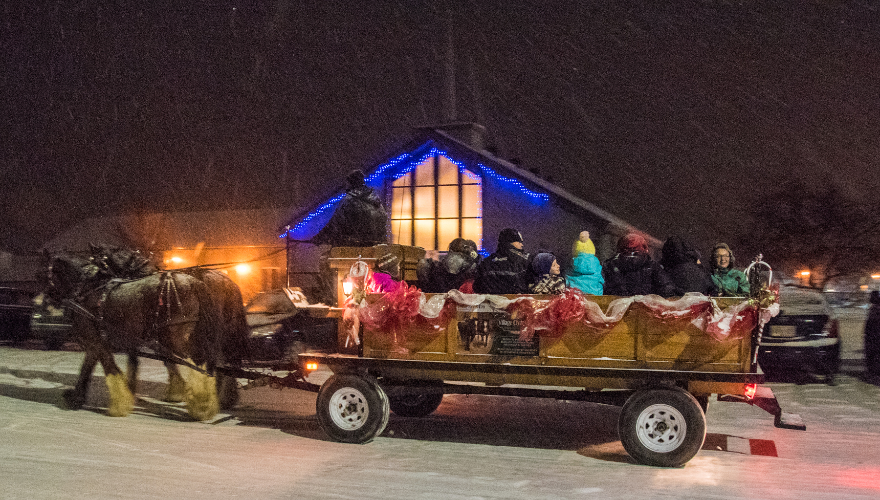 "What's more Canadian than a sleigh ride? A horse-drawn wagon from Village Clydesdales, located near North Bay, trots past the base chapel during the ""Jingle on a Sleigh"" even at 22 Wing North Bay, Ontario, on December 11, 2016. Jingle on a Sleigh is organized for 22 Wing members and their families by a number of base organizations. PHOTO: Corporal Joseph Morin, NB02-2016-0160-021"