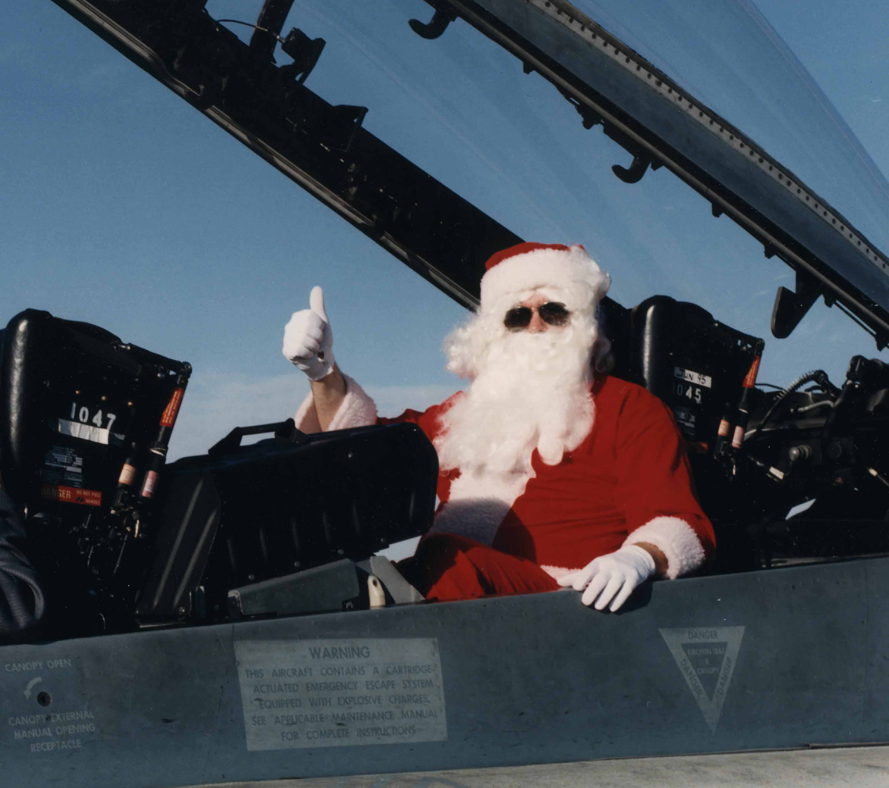 "Santa Claus is normally a traditionalist who enjoys flying his sleigh pulled by tiny reindeer. But he sometimes ""kicks the tires"" on other types of transportation. Here, Santa (Chris Charland) gives a thumbs up to a CF-188 Hornet at 22 Wing North Bay, Ontario, in this undated photo. PHOTO: Courtesy Chris Charland"
