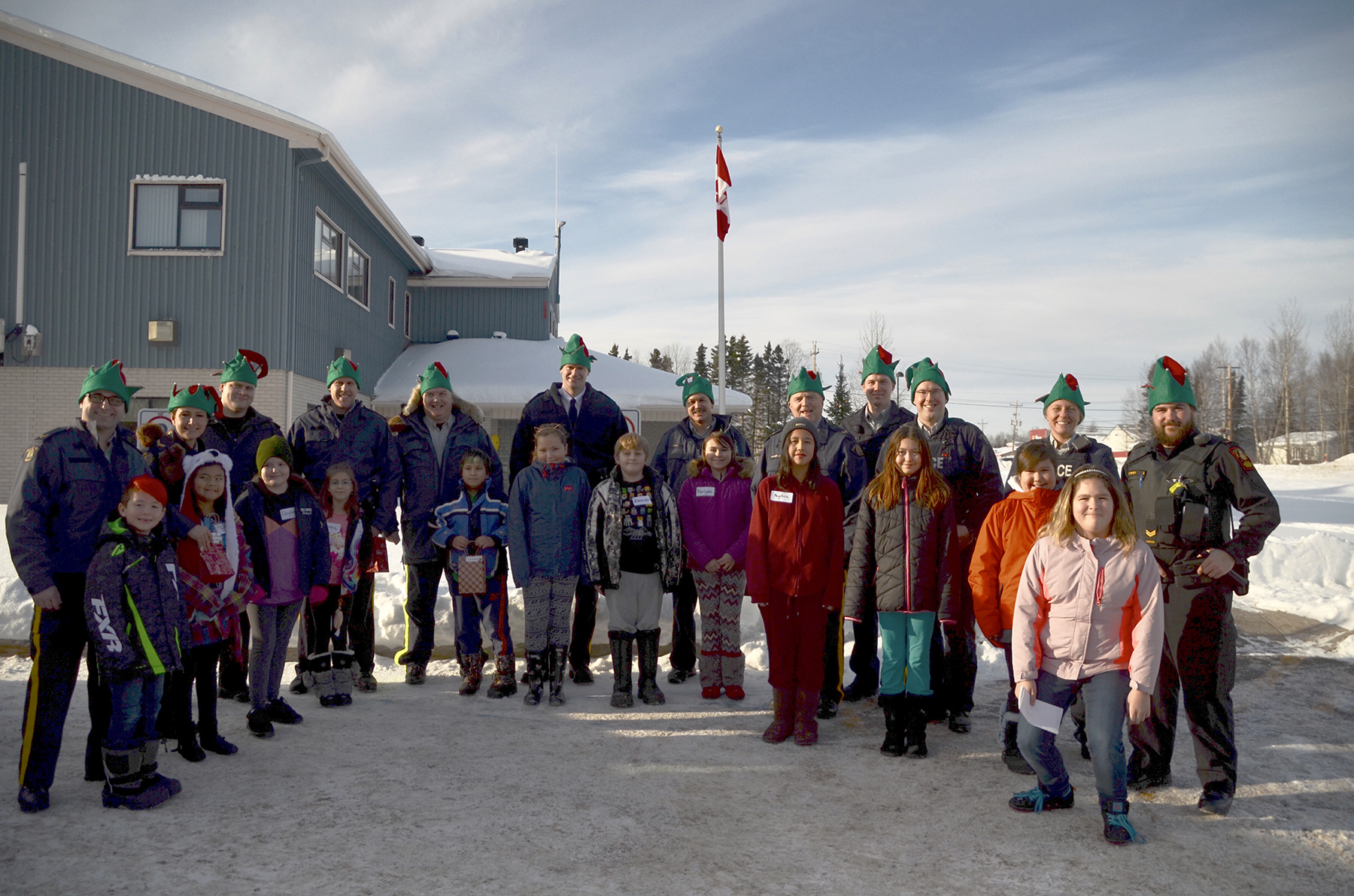 Twelve young people from Happy Valley-Goose Bay, Labrador, gather with their personal elves from the local area during Shop with a Cop day on December 3, 2017. PHOTO: Submitted