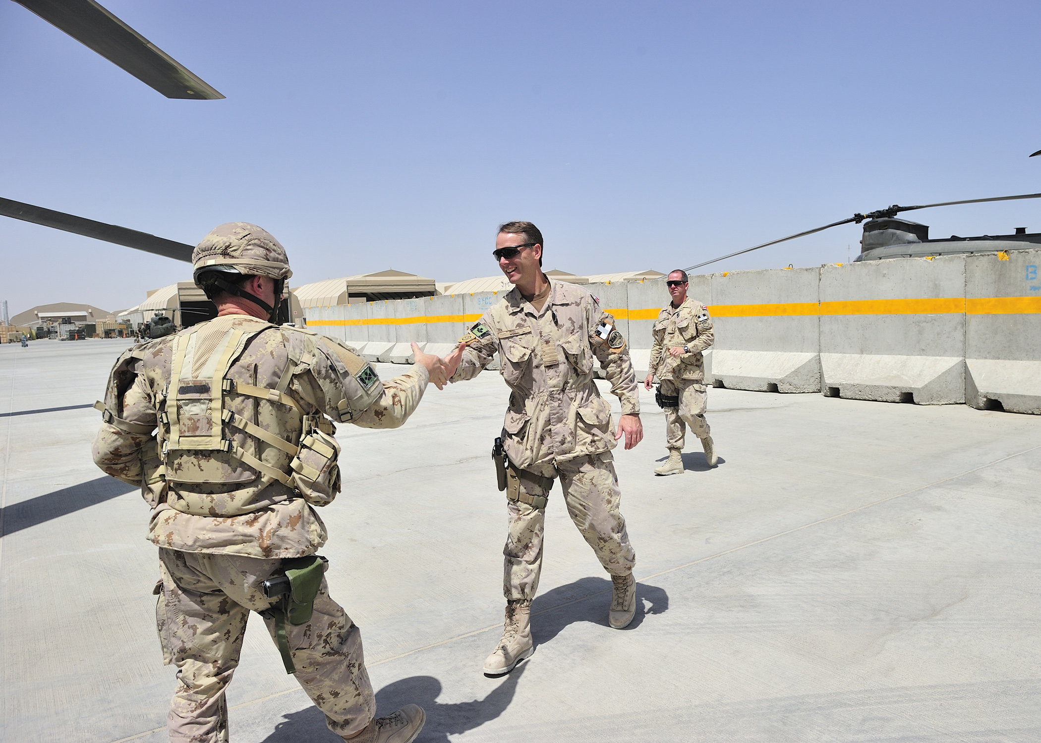 Colonel Al Meinzinger (right), commander of the Air Wing, Task Force Silver Dart, greets Brigadier-General Charles Lamarre, commander of the Mission Transition Task Force, on 22 July 22, 2011, in Kandahar, Afghanistan. On May 4, 2018, now-Lieutenant-General Meinzinger took command of the Royal Canadian Air Force. PHOTO: Master Corporal Dan Shouinard, AR2011-0294-124