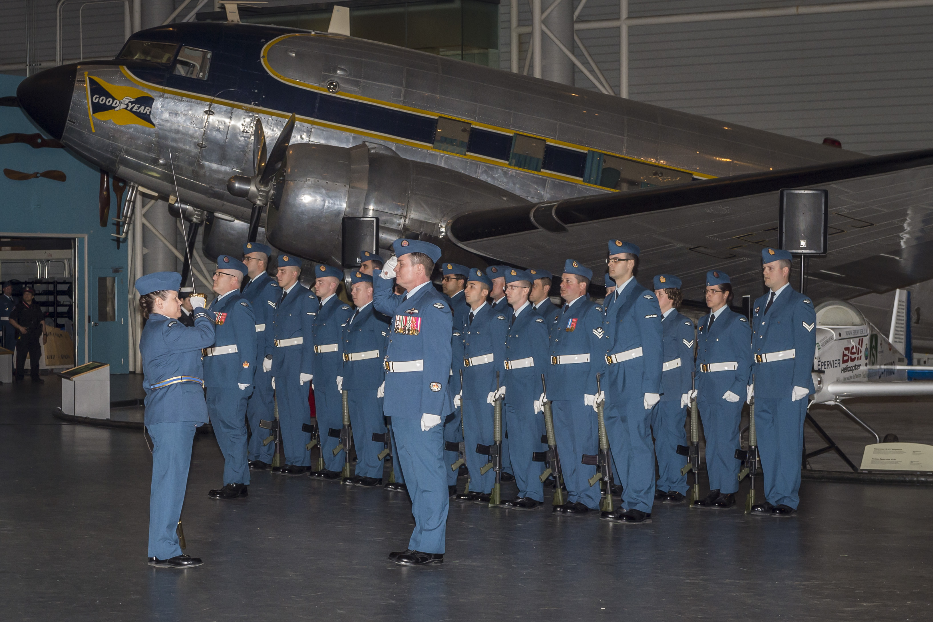Salutes are exchanged during the Change of Command parade, held at the Canada Aviation and Space Museum in Ottawa. The Change of Command was held inside the museum due to inclement weather. PHOTO: Corporal Alana Morin, FA03-2018-0040-018