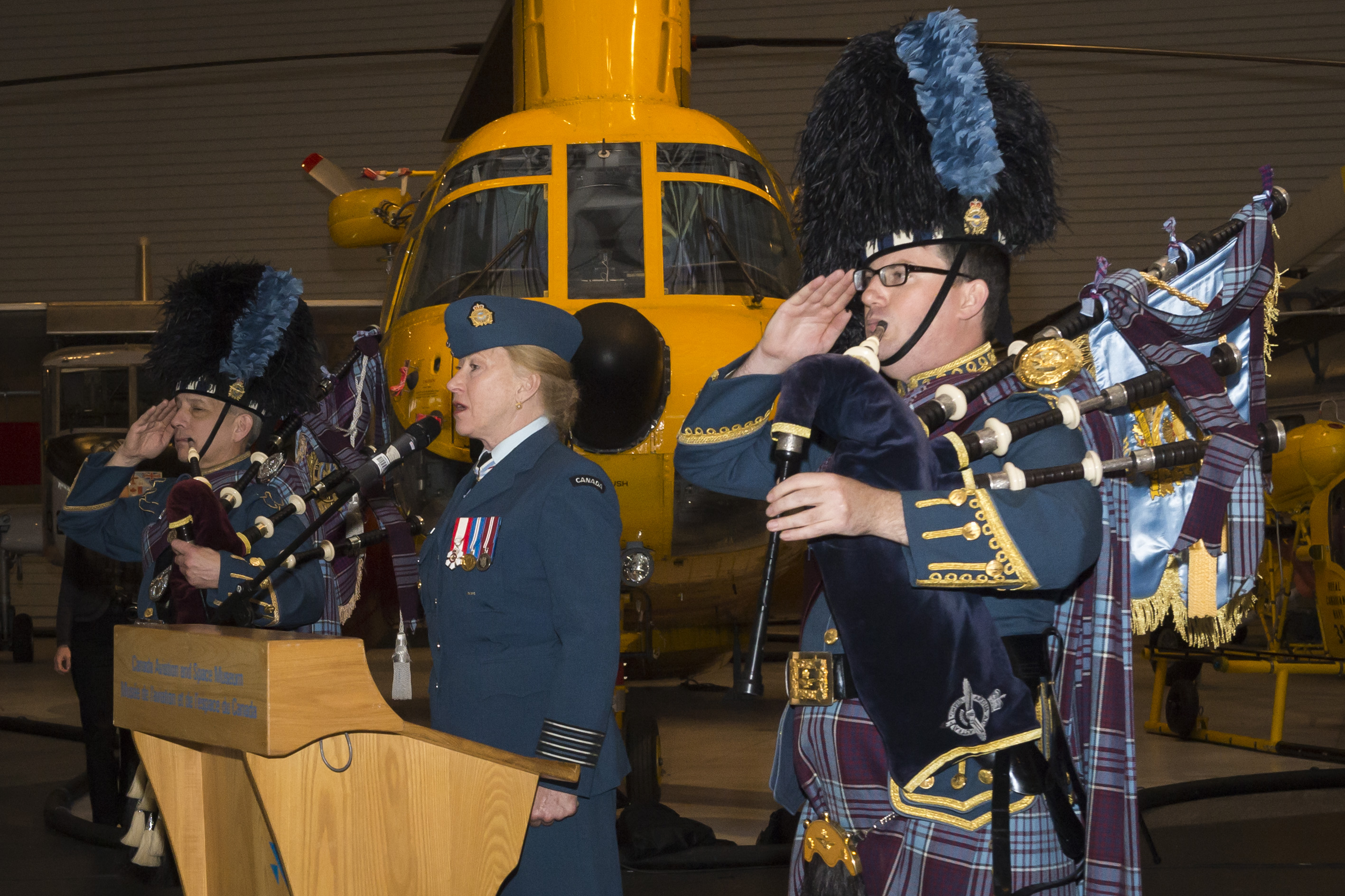 "The RCAF's honorary colonel, Canadian singer-songwriter Loreena McKennitt, sings ""O Canada"" as the change of command ceremony begins. PHOTO: Corporal Alana Morin, FA03-2018-0040-025"