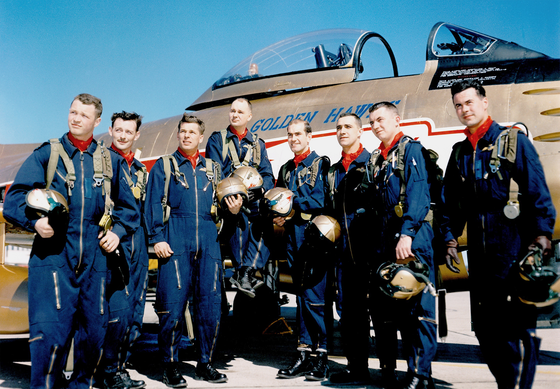 The Golden Hawk pilots of 1959, from left: Flying Officer Bill Stewart, Flying Officer Jim Holt, Flight Lieutenant J.T. Price, Squadron Leader Fern Villeneuve (team leader), Flight Lieutenant Ed Rozdeba, Flight Lieutenant Ralph Annis (lead solo), Flight Lieutenant Jim McCombe, Flight Lieutenant Jeb Kerr PHOTO: RCAF, courtesy of Dan Dempsey