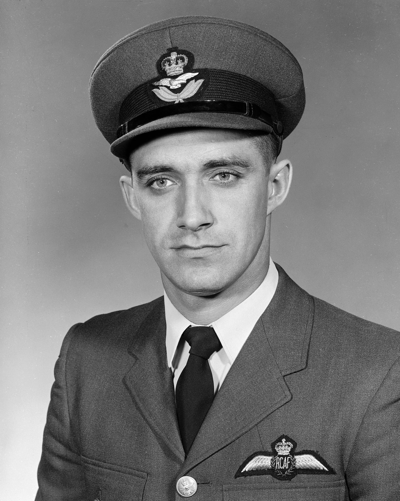 Flight Lieutenant Ralph Annis sits for an official photograph in 1960. PHOTO: DND Archives, PL-133019
