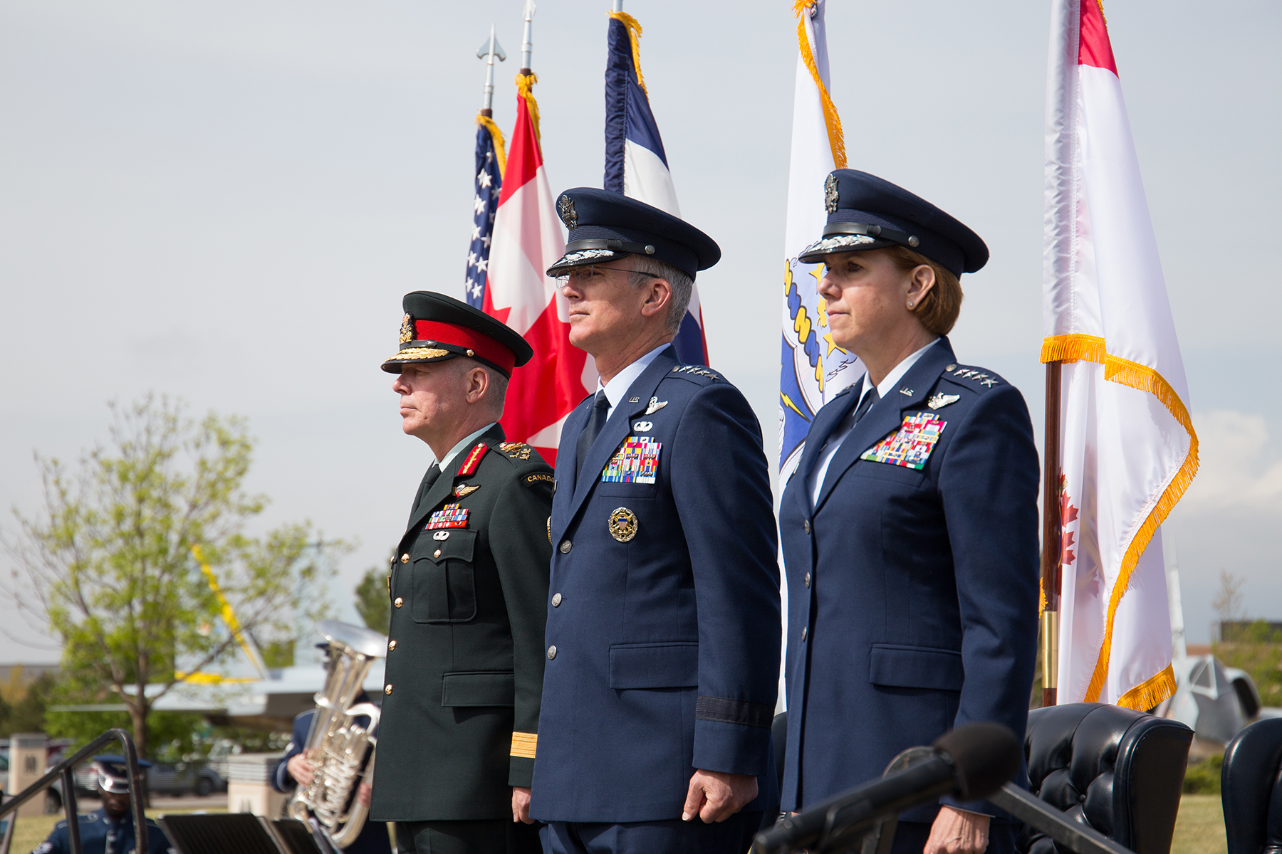 Canada's Chief of the Defence Staff, General Jonathan H. Vance (left), Vice Chairman of the Joint Chiefs of Staff U.S. Air Force General Paul J. Selva, and the Commander of the North American Aerospace Defense Command and U.S. Northern Command, U.S. Air Force General Lori Robinson, participate in the NORAD 60th Anniversary Ceremony on Peterson Air Force Base Colorado, on May 12, 2018. PHOTO: U.S. DoD, Jhomil Bansil