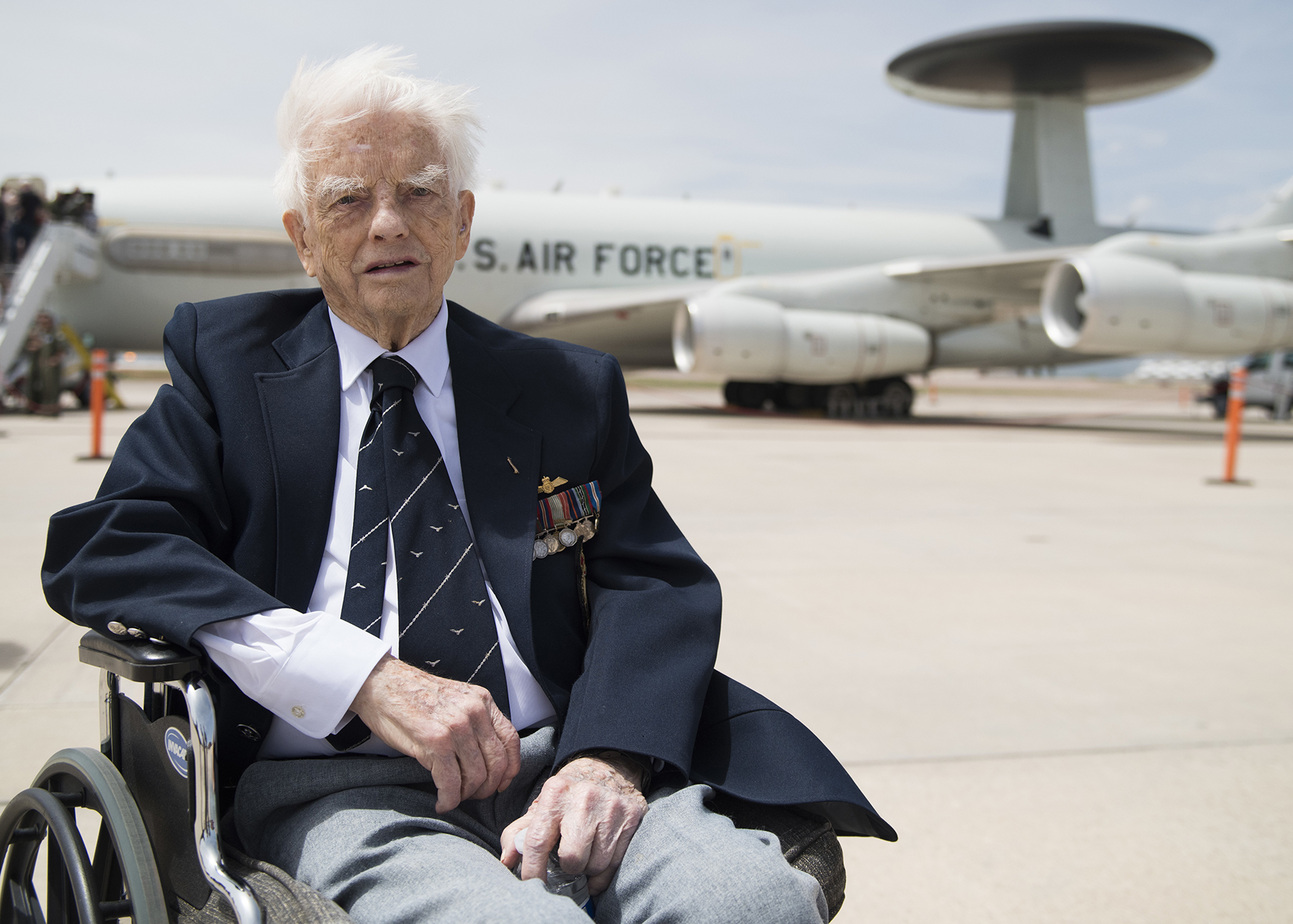 RCAF Second World War veteran Squadron Leader (retired) George Sweanor, 98, pauses for a photo at the North American Aerospace Defense Command's 60th Anniversary Ceremony on Peterson Air Force Base Colorado, May 12, 2018. In 1942, Squadron Leader Sweanor was shot down and captured after multiple flights over enemy td him.erritory, and spent 800 days as a prisoner of war. PHOTO: U.S. DoD, Staff Sergeant Emily Kenney